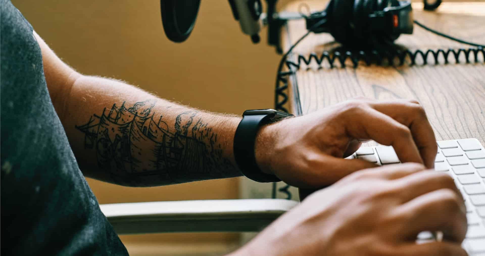 man manually transcribing using Google Docs