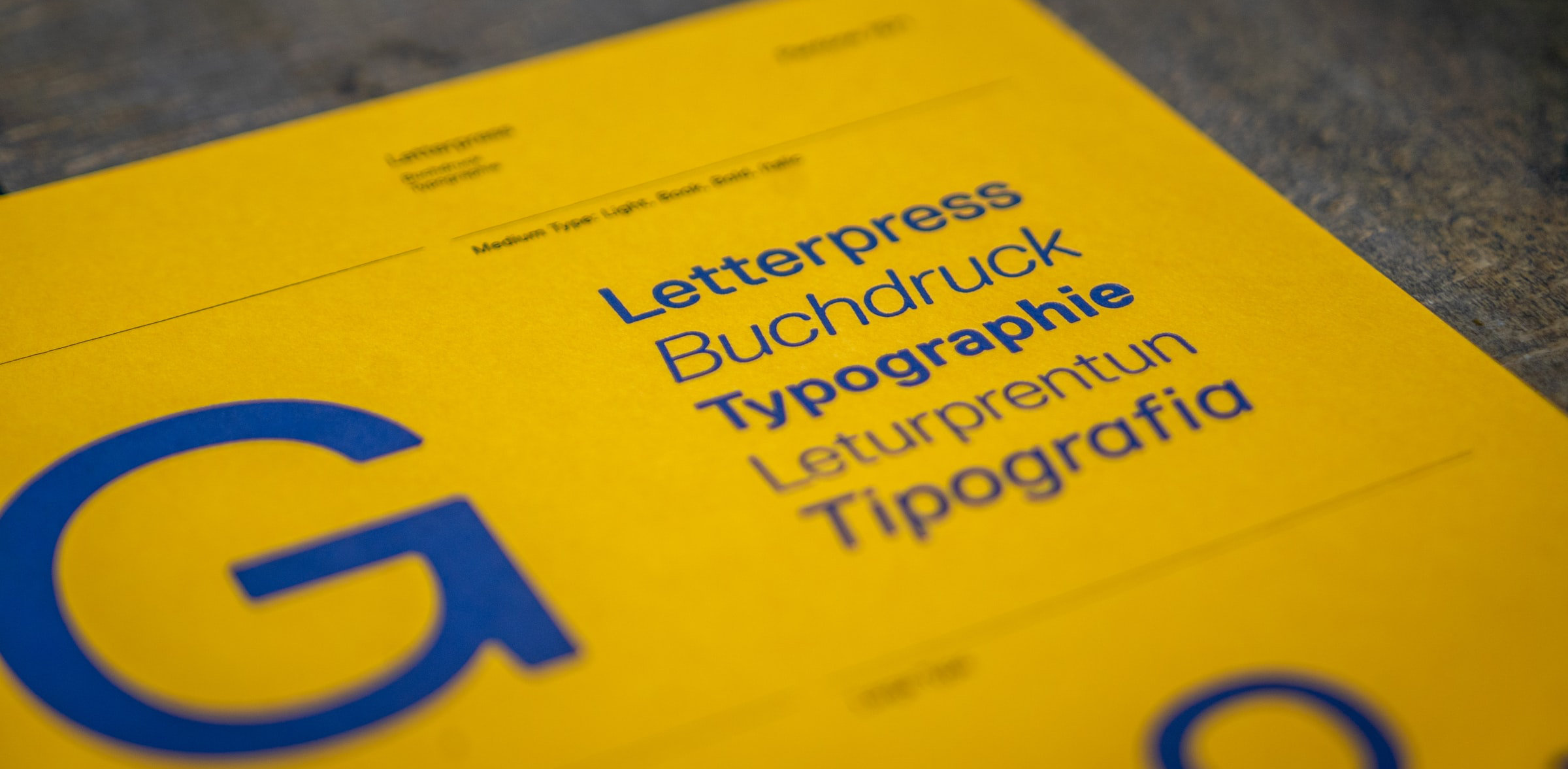 blue typography letters on yellow background